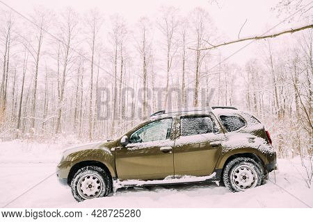 Gomel, Belarus - December 25, 2018: Renault Duster Suv Parked In Snowy Forest. Duster Produced Joint