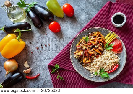 Traditional Vegan Korean Foods. Brown Rice With Eggplant Vegetables. Simple Asian Summer Organic Foo