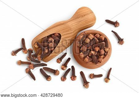 Dry Cloves In Wooden Bowl And Scoop Isolated On White Background With Clipping Path. Top View. Flat
