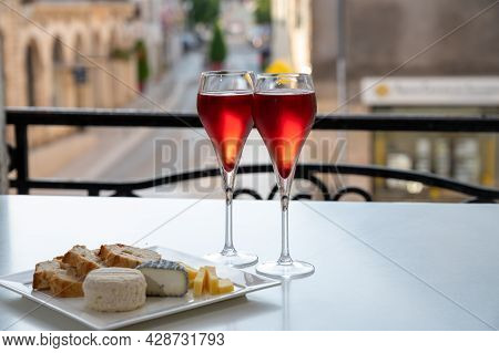 Drinking Of Kir Royal,  French Aperitif Cocktail Made  From Creme De Cassis Topped With Champagne, T
