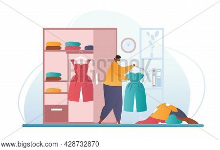 Cleaning The Closet Concept. Woman Takes Apart The Wardrobe And Carefully Folds The Clothes. Conveni