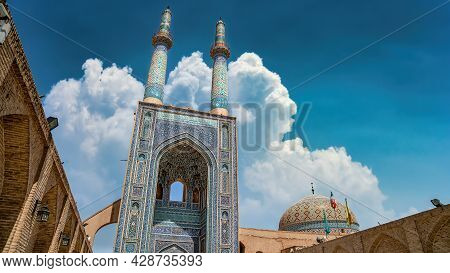 Yazd, Iran - May 2019: Local People And Tourists Around The Gate And Minarets Of Jameh Mosque Of Yaz