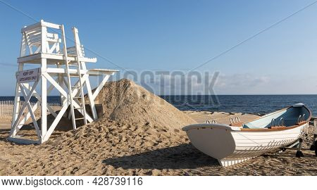 White Wooden Lifeguard Stand And Rowboat On The Beach Looking Toward The Long Island Sound At Sunken