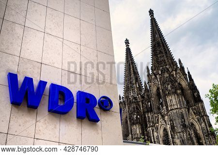 Cologne, Germany - May 23, 2021: Logo On The Facade Of The Wdr Broadcasting Building, In The Backgro