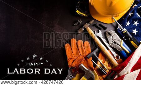 Happy Labor Day Concept. American Flag With Different Construction Tools With The Text On Dark Stone