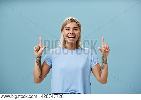 Waist-up Shot Of Upbeat Creative Stylish And Gorgeous Blonde Female Student Have Tattoos On Arms Poi