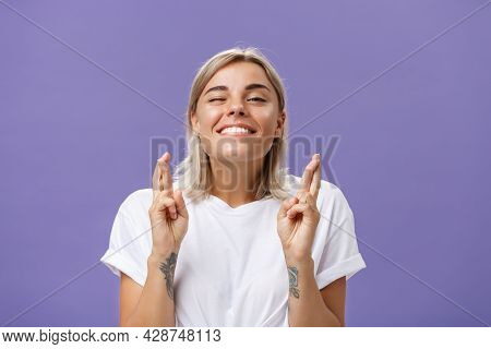 Waist-up Shot Of Hopeful Optimistic Attractive Stylish Woman In White T-shirt With Tattooed Arms Win