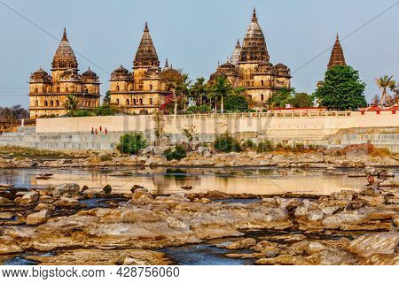 Tourist indian landmark - view of Royal cenotaphs of Orchha over Betwa river. Orchha, Madhya Pradesh, India