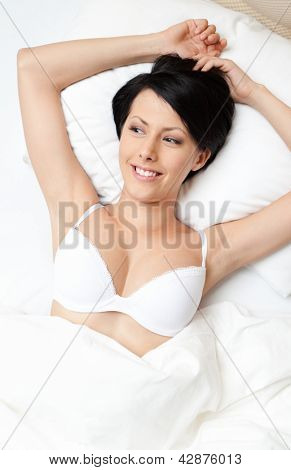 Sleeping woman in the bedstead, white background