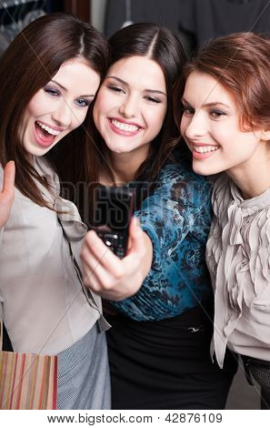 Three pretty girls take photo after shopping at the mall