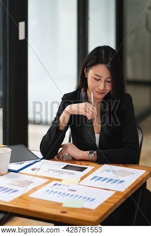 Portrait Of Attractive Asian Businesswoman Working For Marketing Plan. Business Analysis, Financial