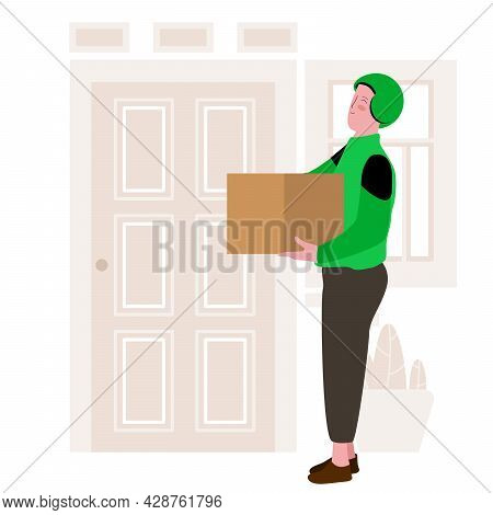 Driver Of Instant Delivery Using Green Helm Is Handling The Package And Standing In Front Of The Doo
