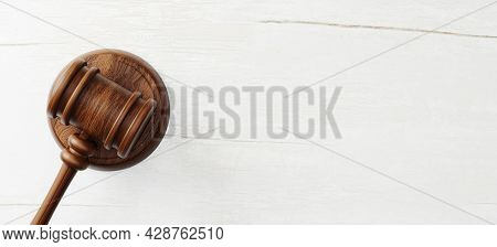 Top View Of Judge Gavel On Wooden Background. Law And Justice, Legality Concept. 3d Illustration