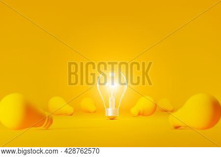 Light Bulb Bright Outstanding Among Lightbulb On Yellow Background. Concept Of Creative Idea And Inn
