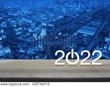 2022 Start Up Business Flat Icon On Wooden Table Over Modern City Tower, Street, Expressway And Skys