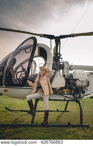 Blonde Tween Girl Near Helicopter Looking Into Distance