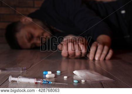 Overdosed Man Indoors, Focus On Different Drugs
