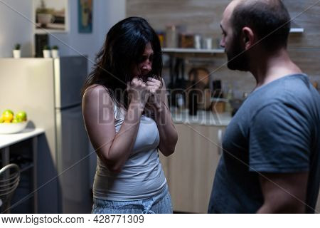 Terrified Unhappy Woman In Argument With Violent Man Fighting And Yelling. Aggressive Husband Abusin