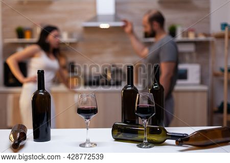 Close Up Of Bottles And Glasses Filled With Wine, Liquor, Booze And Alcoholic Beverage For Alcohol A