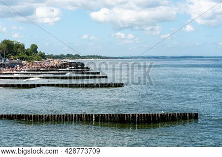 A Breakwater Made Of Logs Cuts Through The Sea Wave. The Baltic Sea.