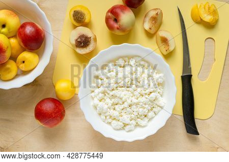 Ingredients For Healthy Breakfast. Cottage Cheese And Nectarines On Wooden Background, Top View