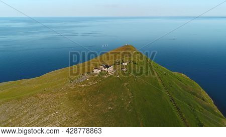 Houses On Top Of Sea Cape. Shot. Remote Life In House On Promontory With View Of Sea Horizon. Top Vi