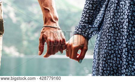 Couple Walking. Happy Young Romantic People Holding Hands. Love Couple Man And Woman Together In Sum