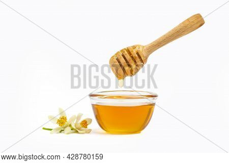 Honey In Bowl With Wooden Honey Dipper Isolated On White Background. Healthy Organic, Natural Food,