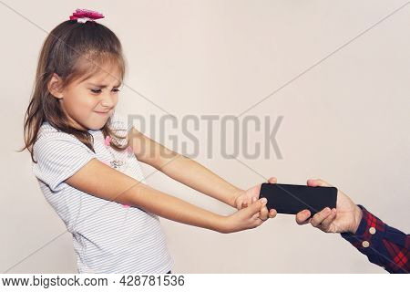 Father Takes The Phone From His Daughter. Childrens Addiction To Mobile Games. A Thief Stole A Child