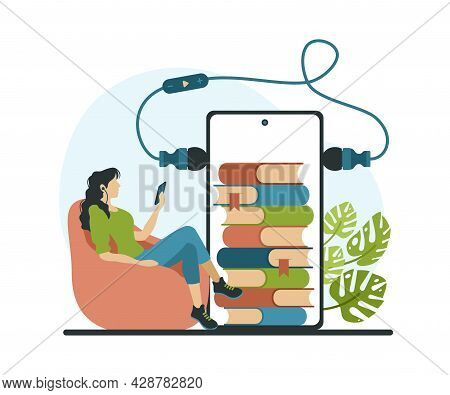 Reading And Listening To Online Books. Woman With Headphones Is Listened To New Novel Through Mobile