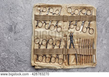 Military Medical Field Surgical Kit. Working Tool Of A Mid-field Surgeon Operating Tweezers Clamps.