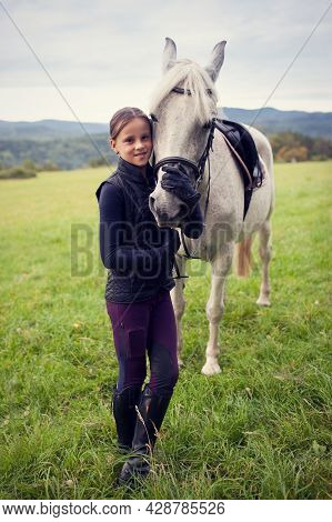 Girl With Horse. Girl With Horse. Friendship Between A Girl And A Horse. The Girl Is Petting Her Hor