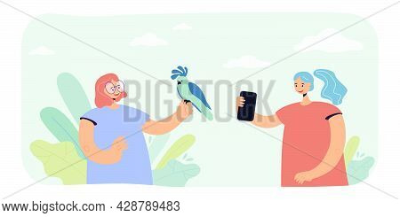 Friends Photographing With Parrot. Flat Vector Illustration. Two Girls Holding Parrot On Hand And Ta