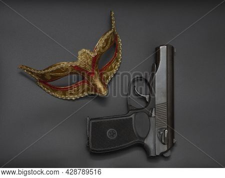 Gun, Pistol, Traditional Golden Carnival Venetian Mask With Red Ornament On Black Background. Prepar