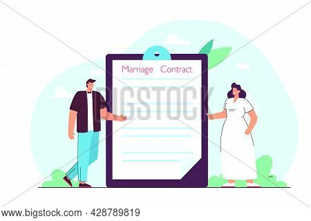 Groom And Bride Standing Next To Folder With Marriage Contract. Tiny Wife And Husband Signing Prenup