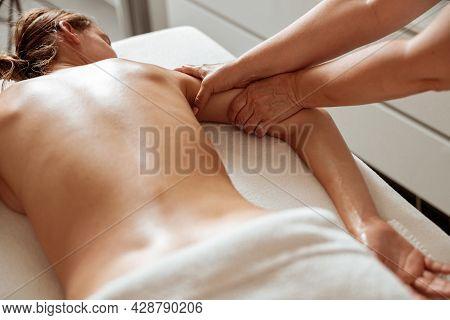 Masseuse Hands Massaging Woman Arm In Spa Salon