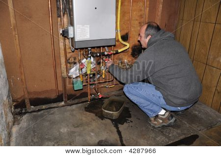Man Fixing Furnace