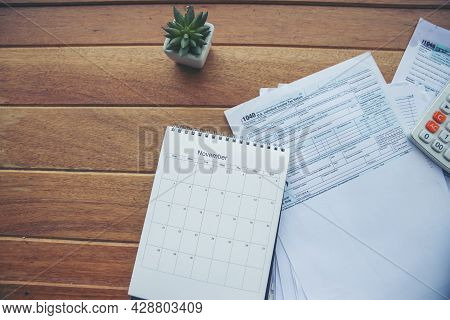 Top View Of Individual Income Tax Return Form, Calendar And Calculator For Who Have Income According