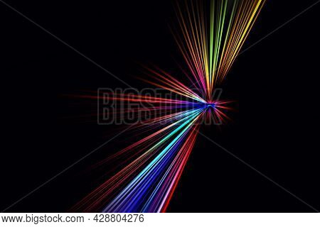 Abstract Surface Of Blur Radial Zoom In Blue, Red, Yellow Tones On Black Background. Abstract Backgr