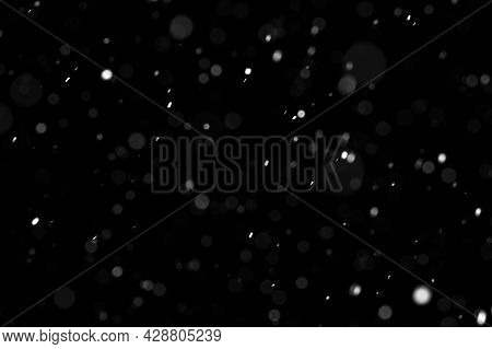 Bokeh Of White Snow On A Black Background. Falling Snowflakes On Night Sky Background, Isolated For