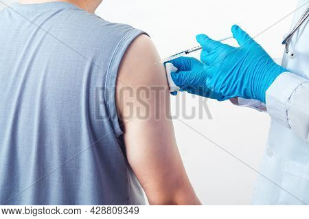 General Practitioner Vaccinating Injection Immunity Covid-19 Vaccine Dose To Patient Muscle Arm Shou