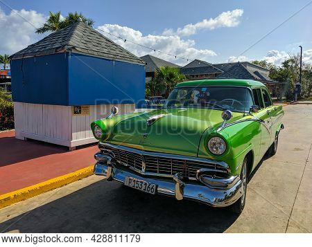 Cayo Coco, Cuba, 16 May 2021: Ford Fairlane Car Is Parked Outside A Cuban Hotel. The Bright Green 19