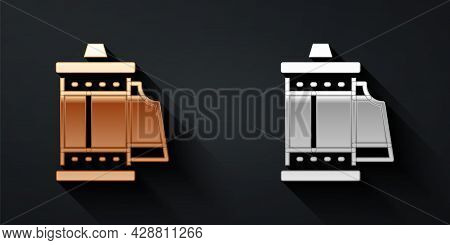 Gold And Silver Camera Vintage Film Roll Cartridge Icon Isolated On Black Background. 35mm Film Cani