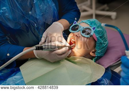 Oral Hygiene And Treatment Of The Child. Teeth Cleaning At Stomatologist