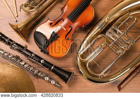 Set Of Different Musical Instruments On Wooden Background, Flat Lay
