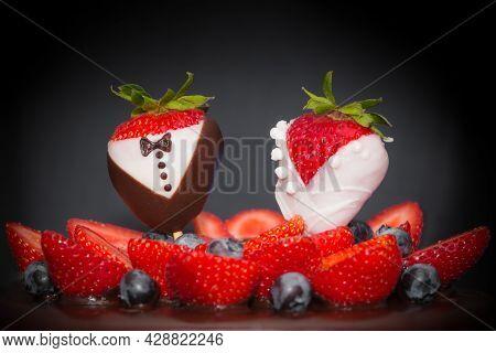 Strawberry Bridal Couple Bride Groom At Chocolate Wedding Cake. Confectionery Luxury Art Trend Marri