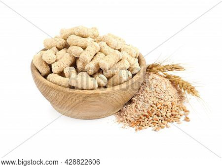 Granulated Wheat Bran In Bowl And Spikelets On White Background