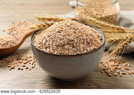 Wheat Bran And Kernels On Wooden Table