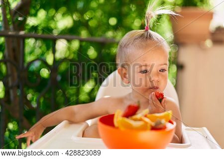 Little Girl Eats Strawberries, Lost In Thought