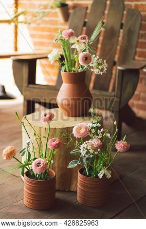 Ranunculus Flowers In Clay Pots On The Terrace. Beautiful Flowers In A Vase